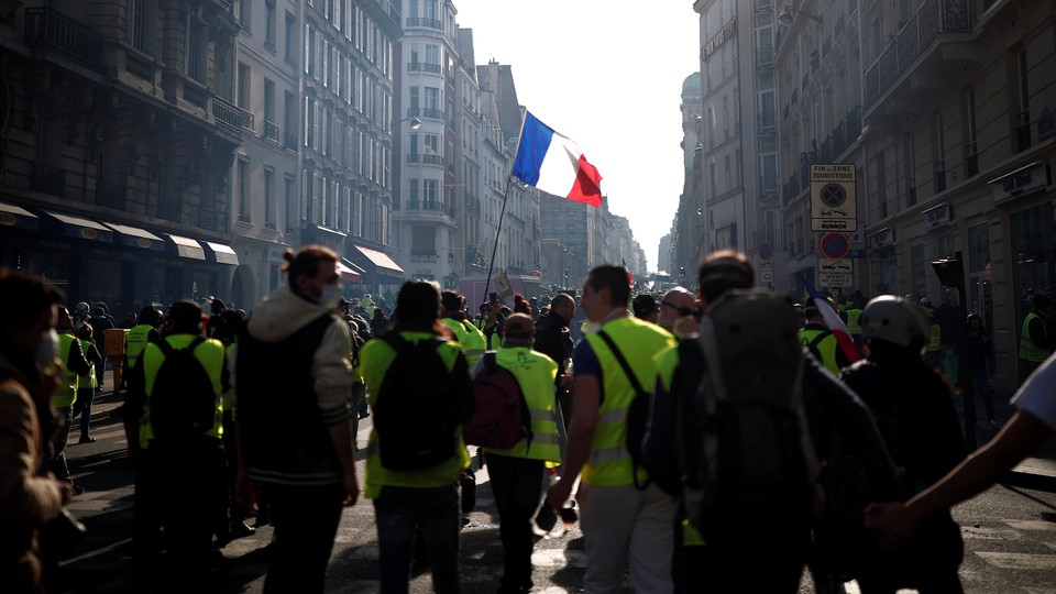 Yellow-vest protesters attend a demonstration in Paris on February 16.