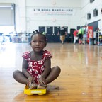 photo: A young girl from the Democratic Republic of the Congo awaits resettlement in a gym in Portland, Maine, in 2019.