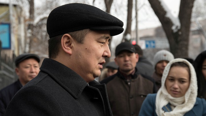Serikzhan Bilash addresses reporters outside a courthouse in Almaty, Kazakhstan.