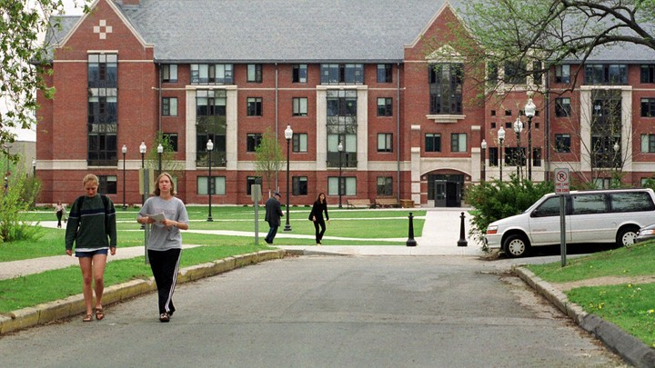 Students walk on the University of Connecticut campus where the creation of a black-male-only living space was recently announced.