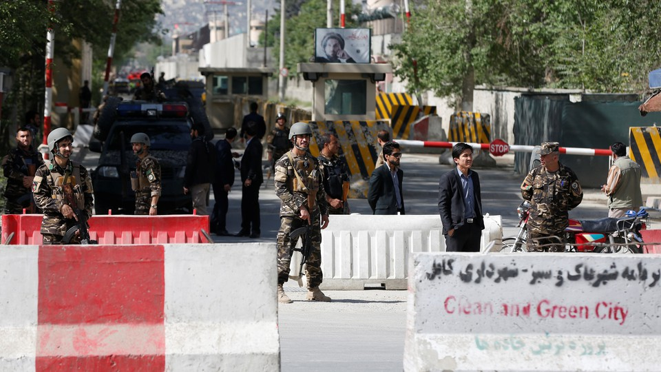 Afghan security next to road barriers