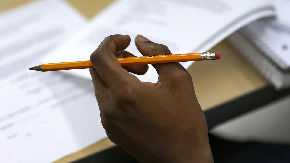 A hand holds a pencil