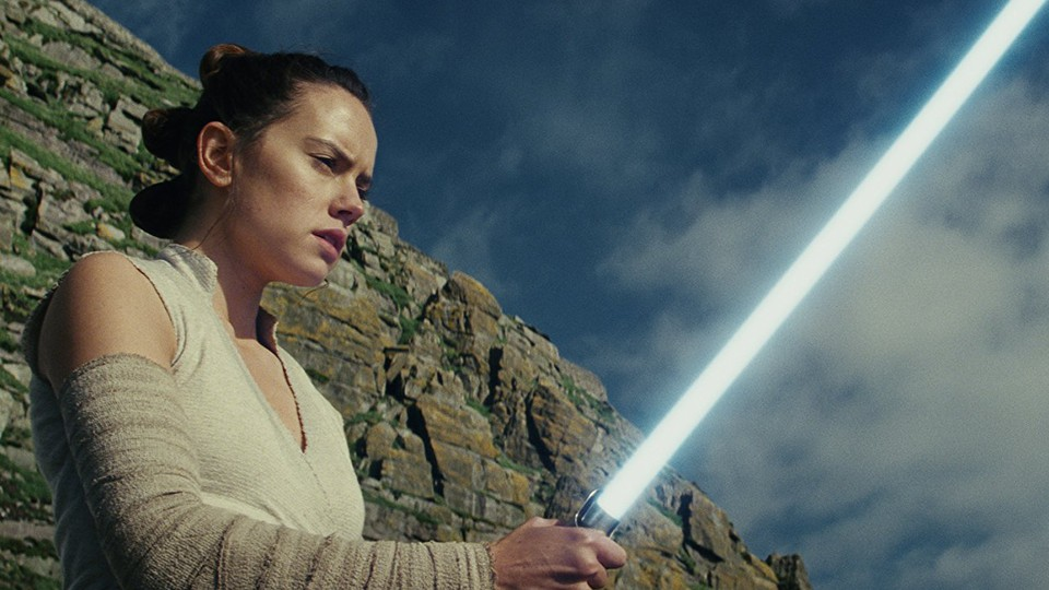 Rey holding a lightsaber in 'Star Wars: The Last Jedi'