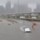 Interstate 45 submerged in Houston with parked cars and trucks