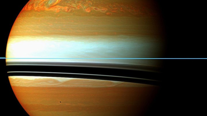NASA handout image shows Saturn's atmosphere and its rings in a false color composite made from 12 images taken from the Cassini aircraft, captured on January 12, 2011.