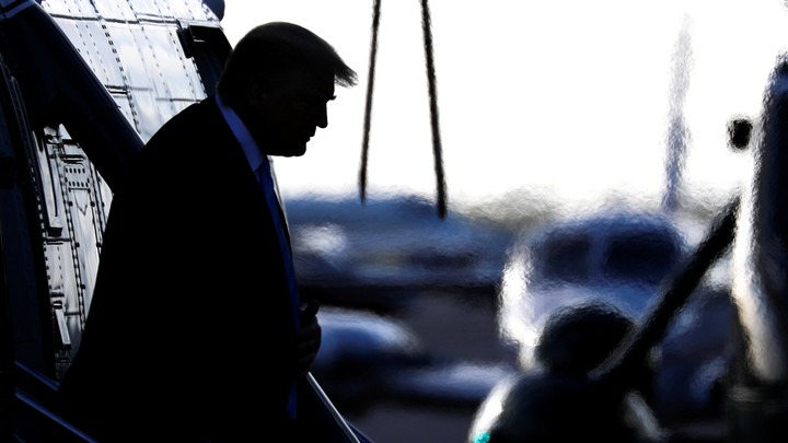 Donald Trump walks down the steps of Marine One.