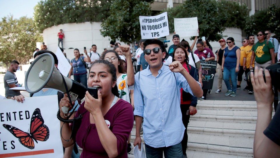 Students are seen with megaphones and signs, protesting.