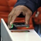 A shopper scans an Amazon Go app on a cellphone.