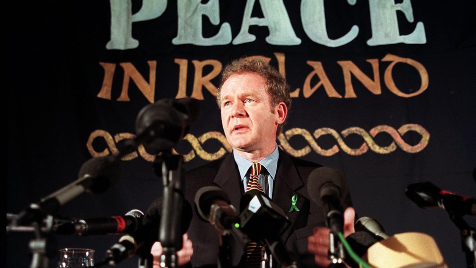 Sinn Fein chief negotiator Martin McGuinness answering journalists' question during a press conference in London in February 1998