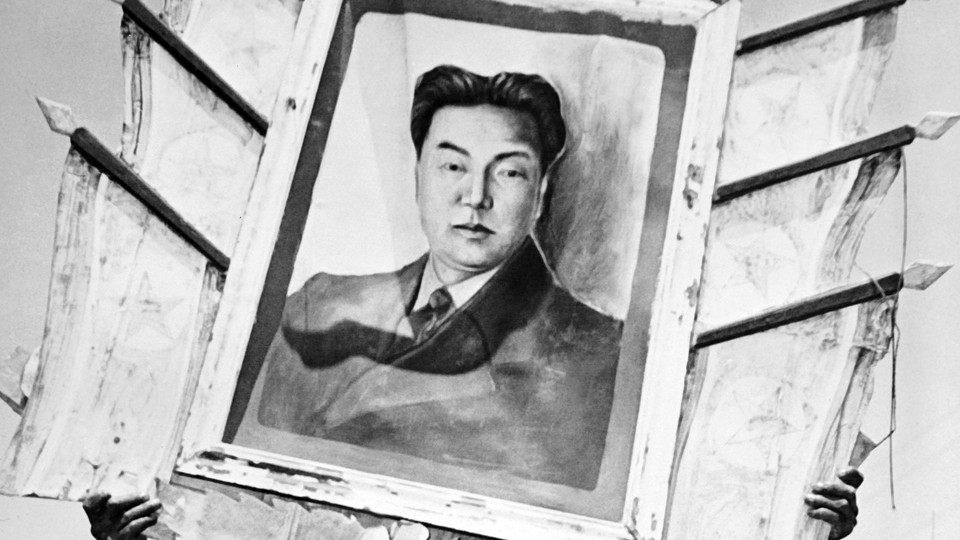 A framed portrait of Kim Il-Sung, North Korea's first Supreme Leader, in 1952.