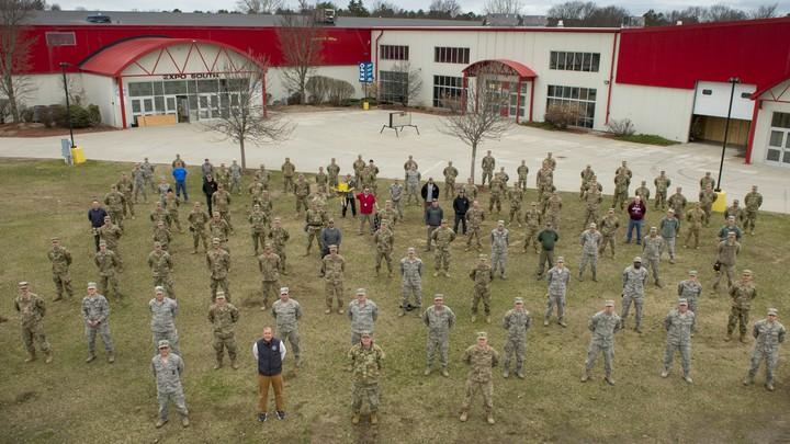 Photo of the Vermont National Guard in front of an expo center that they converted into a hospital