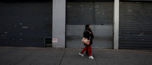 A woman walks past a vacant store in Brooklyn, which, like the other boroughs of New York City, has been struck with a wave of vacant storefronts as rising rents squeeze out smaller businesses.