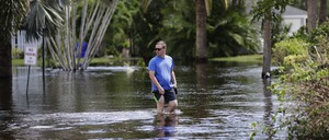 A person wades through water in a flooded development in the aftermath of Hurricane Irma in Fort Myers, Florida.