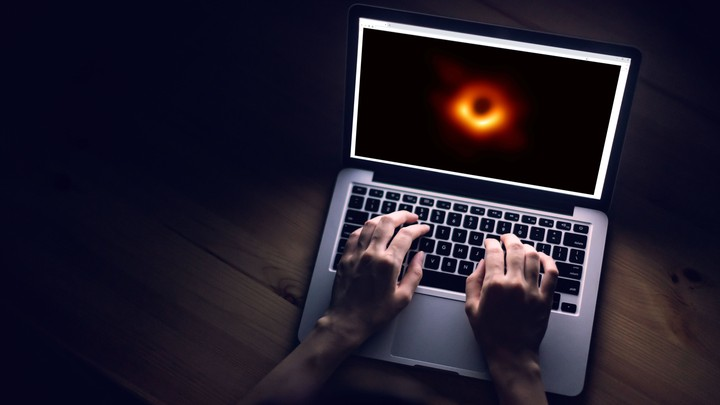 A laptop displays the famous black-hole photo.