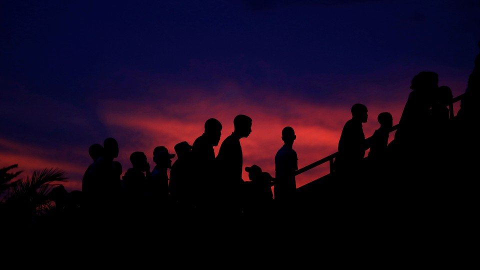 Participants arrive to a night vigil during a commemoration ceremony marking the 25th anniversary of the Rwandan genocide, in Kigali, Rwanda on April 7, 2019