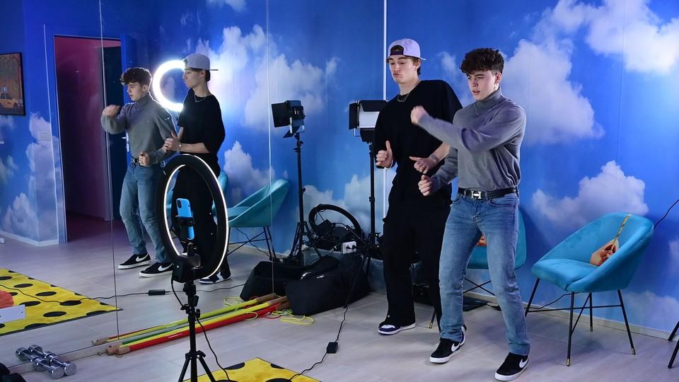 TikTok influencers filming.
