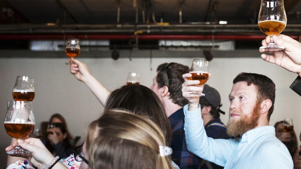 Visitors taste beer at Brooklyn Brewery, in New York