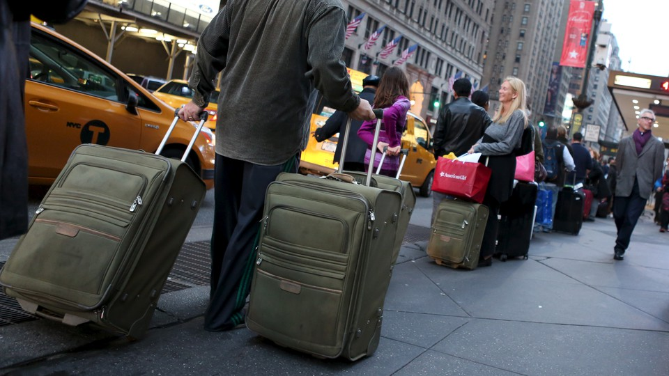 People pulling suitcases