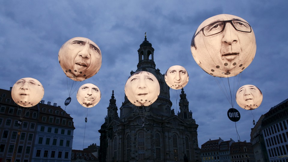 Balloons made by the 'ONE' campaigning organisation depicting leaders of the countries members of the G7 are seen in front of the Frauenkirche cathedral in 2015.