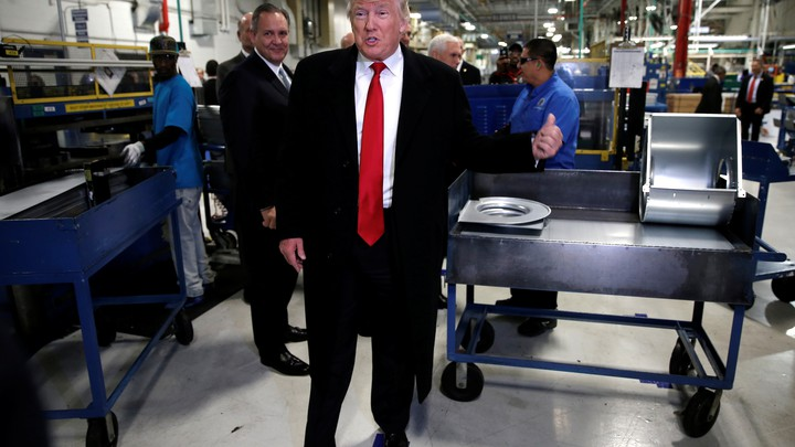 U.S. President-elect Donald Trump speaks to members of the news media as he tours a Carrier factory in Indianapolis, Indiana, on December 1, 2016.