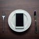 An empty plate with an iPhone on it