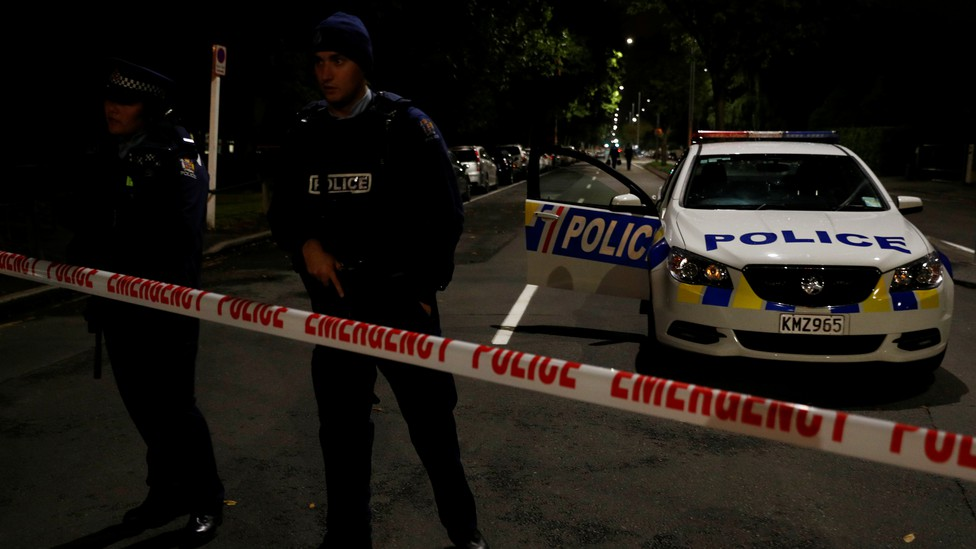Armed police officers stand guard in a perimeter outside Al Noor mosque after the attack in Christchurch.