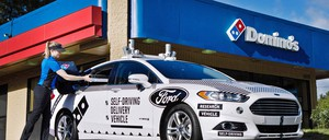 A Domino's-delivering Ford car is pictured.