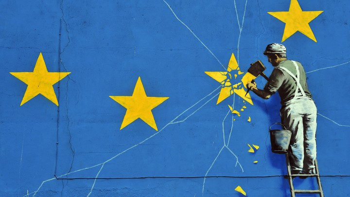 A Banksy mural depicting an EU flag being chiseled by a workman
