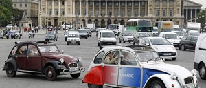 Old cars in Paris are pictured.
