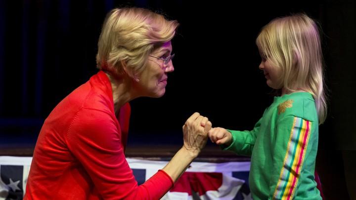 Elizabeth Warren speaking with a young girl