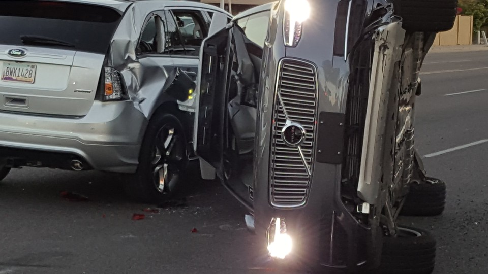 A self-driven Uber-owned Volvo flipped on its side after a collision in Tempe, Arizona. Police say Uber's car did not cause the crash.