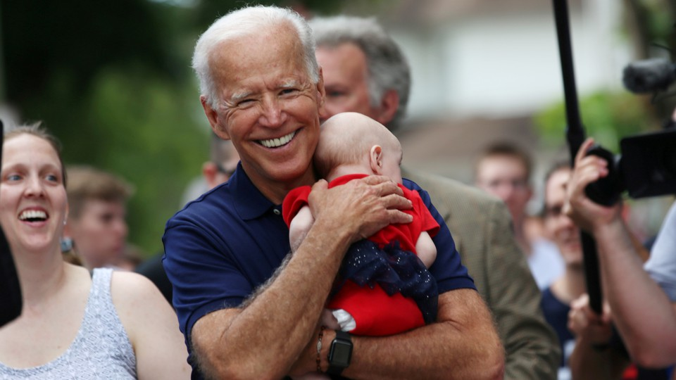 Joe Biden holding a baby