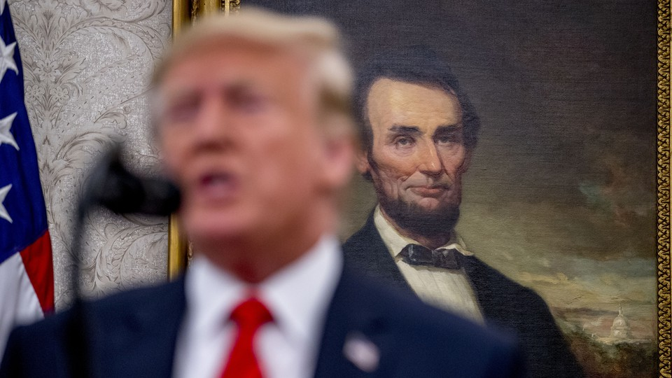 Donald Trump standing in front of a painting of Abraham Lincoln