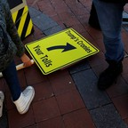 People get ready to protest U.S. President Donald Trump's recently unveiled infrastructure plan outside of the Trump International Hotel in Washington, D.C.