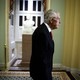 Former Senate Majority Leader Harry Reid walks in a hallway in the Capitol.