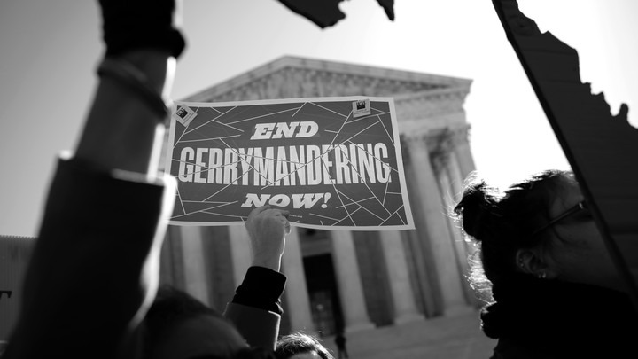 Demonstrators outside the Supreme Court protest the unconstitutionality of gerrymandering, on March 26, 2019.
