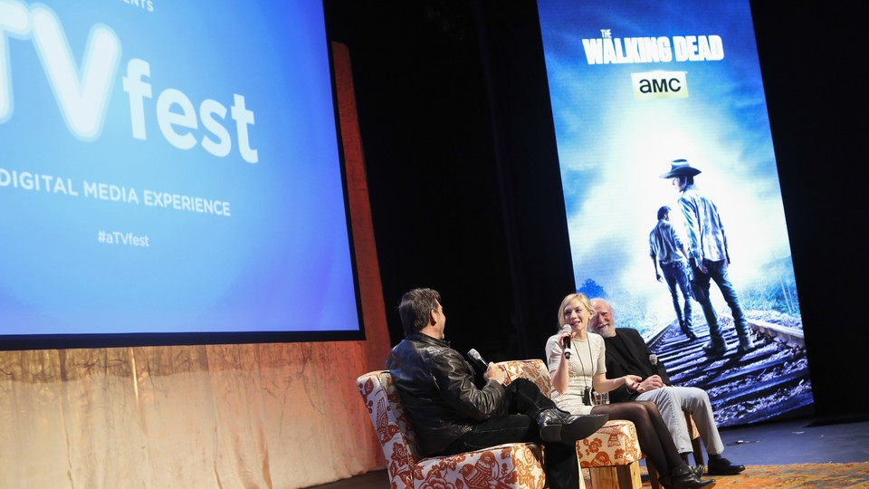 """Actors from the TV show """"The Walking Dead"""" speak onstage."""