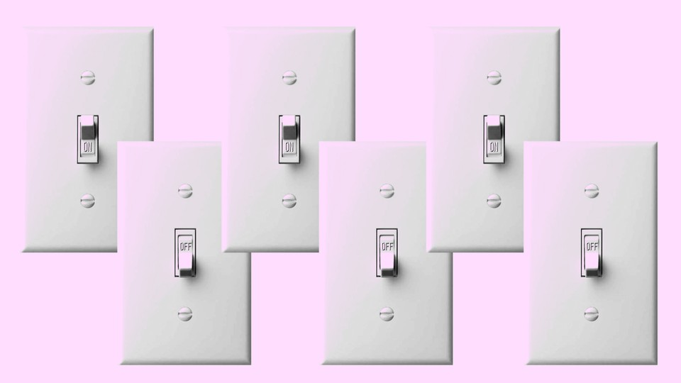 A row of light switches in on and off positions