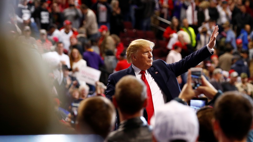 Donald Trump waves to the crowd during a campaign rally.