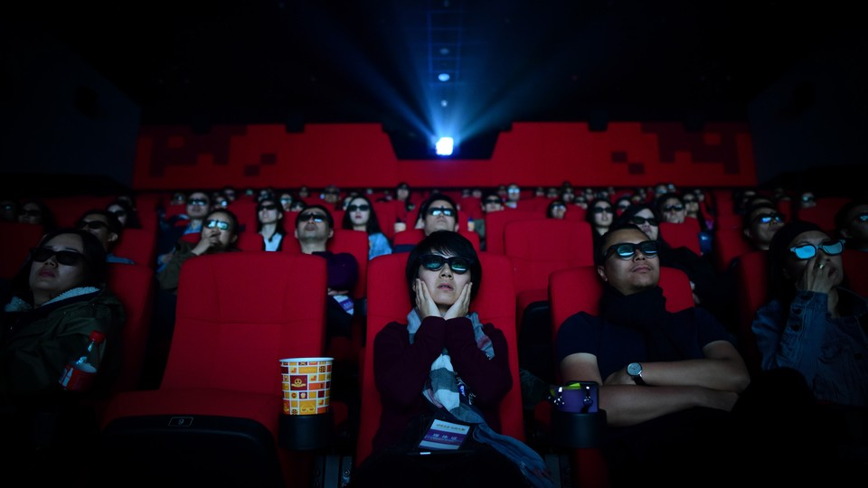 An audience watches a film in a theater in China