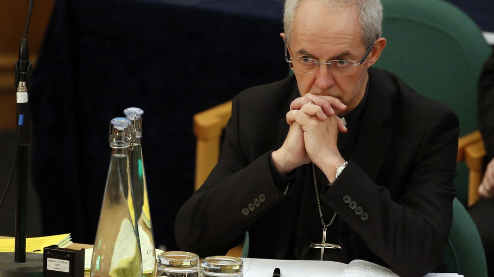 The Archbishop of Canterbury Justin Welby listens to debate at the General Synod in London onFebruary 13, 2017.