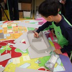 A pupil works on a cardboard architectural model at a Hong Kong primary school.