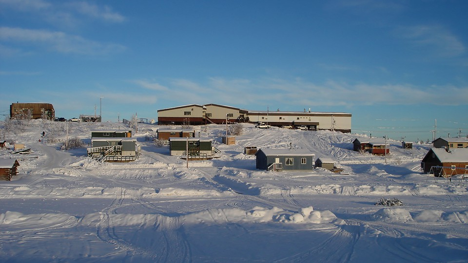 Buildings on a snowy hill in Fort Good Hope