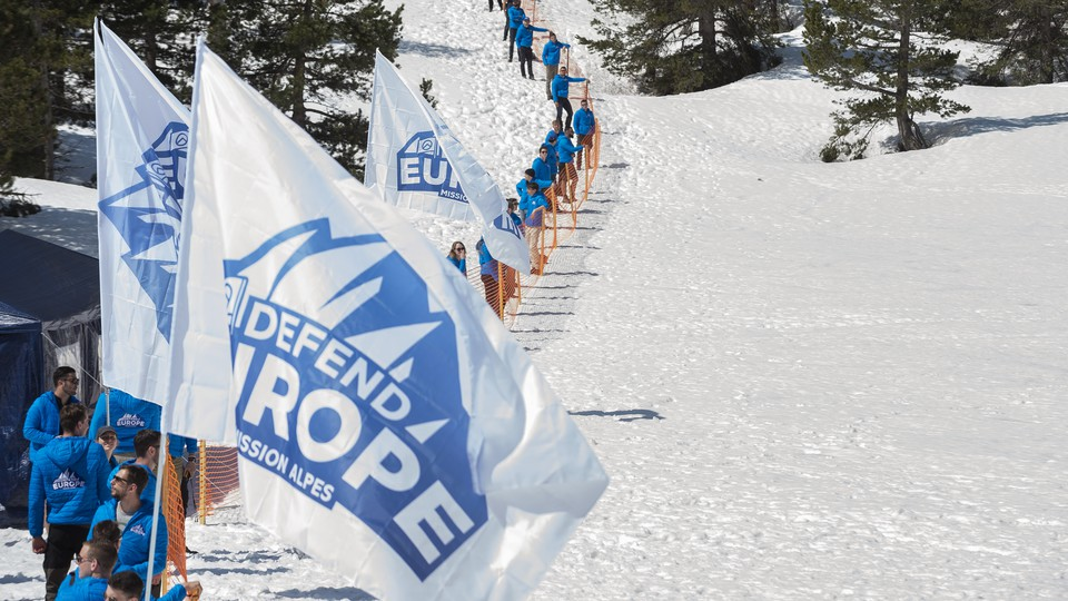 """""""Defend Europe"""" activists construct a makeshift barrier along the French-Italian border in April."""