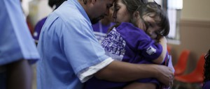 A family embraces as they say goodbye after a visit at San Quentin state prison in California.