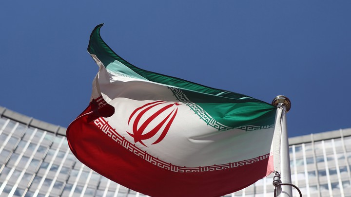 An Iranian flag flutters in front of the United Nations headquarters.
