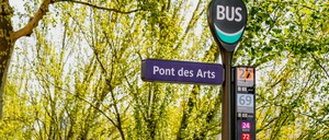 a photo of a bus stop in Paris, France.