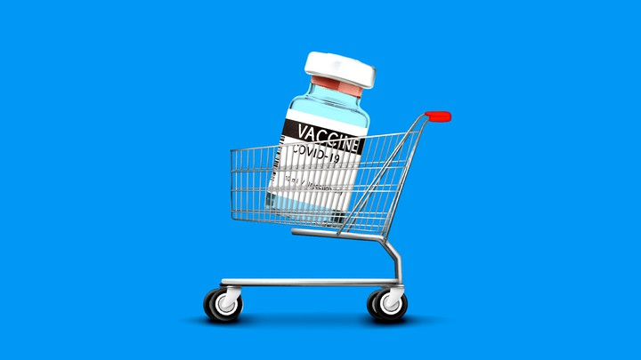 An enlarged COVID-19 vaccine vial in a shopping cart
