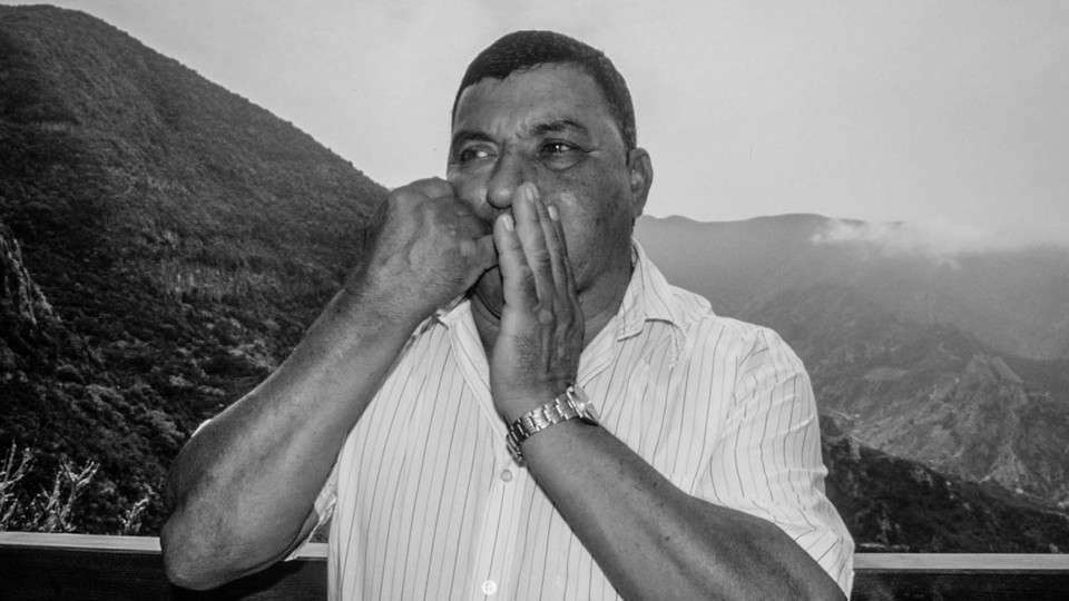 A man whistling with his hands.
