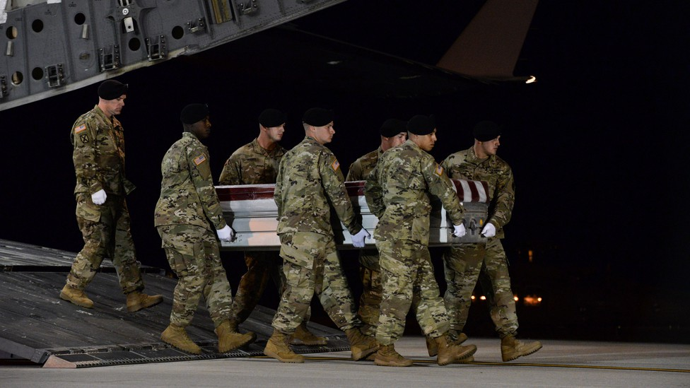 A U.S. Army carry team carried the coffin of Army Staff Sgt. Dustin Wright.